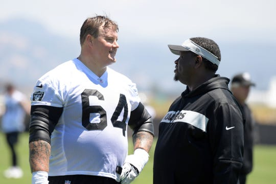 Oakland Raiders guard Richie Incognito, left, talks with assistant offensive line coach Lemuel Jeanpierre during offseason workouts in May.
