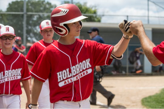 The 2019 Little League Baseball Section 3 Tournament featuring Holbrook vs Two River East. Holbrook's Mike Kisseberth celebrates after scoring a run.Toms River, NJSaturday, July 13, 2019