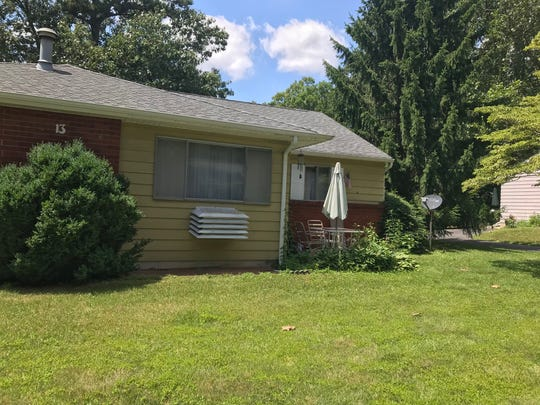 Thomas Foster lived with his 85-year-old mother, Carolyn Foster, in this home on South Heron Street in the Cedar Glen West section of Manchester. Thomas Foster is charged with his mother's murder.