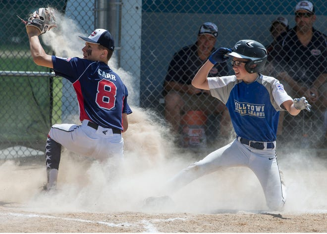 The 2019 Little League Baseball Section 3 Tournament featuring North Howell vs Milltown. North Howell's Gavin Carr attempts to put a tag on Milltown's Cody Rullo at home plate.Toms River, NJSaturday, July 13, 2019