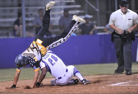 Snyder's Dylan Rodriguez, right, is upended by Pecos pitcher Zeke Saldana while scoring on a wild pitch in the fourth inning. Snyder won the Senior  League game 11-6 at the Texas West State Little League Baseball Tournament July 12 at Kirby Park. The win put Snyder in the title game with a 2-0 record in the double-elimination tournament.