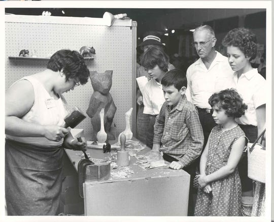 Amanda Crowe, a Cherokee wood carver, demonstrates her skills during the 1960 Craft Fair of the Southern Highlands.