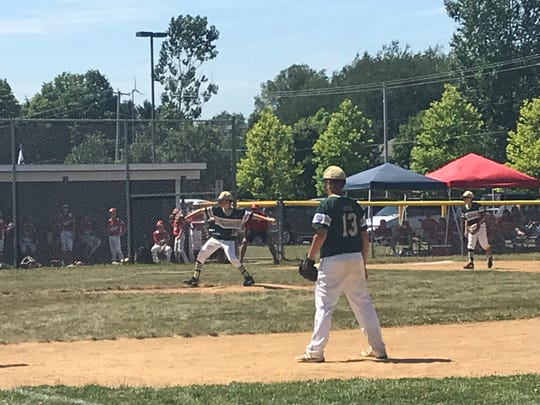 Nolan Grayson delivers pitch for Vestal during Saturday's Section 1 East Tournament game against Baldwinsville at Cortland. Grayson earned the win and homered in Vestal's 7-6 victory.
