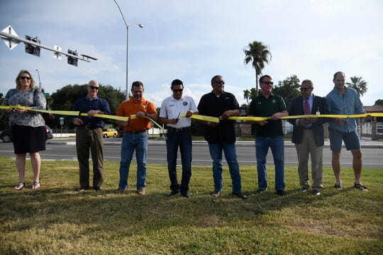 Various members of city council and the Parks and Recreation department cut the ribbon at the new Pedestrian Hybrid Beacon on Ocean Drive and Del Mar Boulevard, Friday, July 12, 2019.