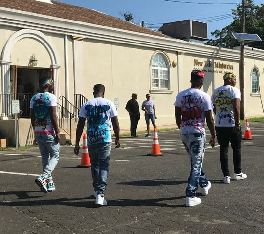 Young men in memorial clothing enter Saturday's services for Camden kidnap victim Curtis Jenkins III.