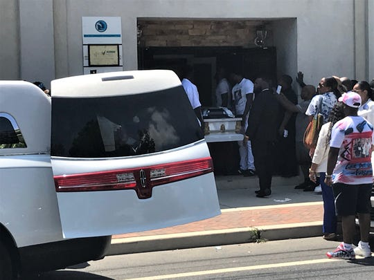 The coffin of Curtis Jenkins III is carried from New Life Ministries in Camden on Saturday.