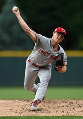 Jul 12, 2019; Denver, CO, USA; Cincinnati Reds starting pitcher Sonny Gray (54) delivers a pitch in the first inning against the Colorado Rockies at Coors Field.