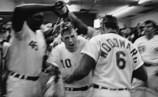 OCTOBER 5, 1970: Pitcher Wayne Simpson dowses rookie manager Sparky Anderson after the Reds won the 1970 National League pennant and were headed for the World Series.