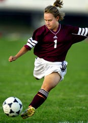 Taken Sept. 19, 2000: Kayla Lockaby of Ross High School gets ready to kick towards the goal as her team battled Kings at Kings High School Tuesday night in the first half of their game.