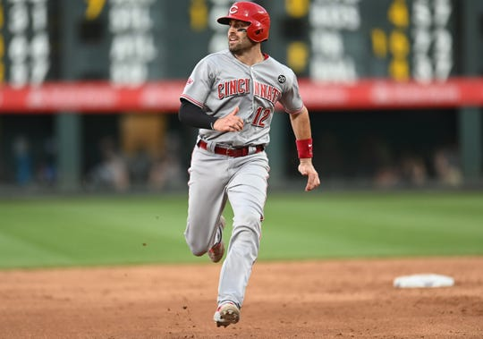 Jul 12, 2019; Denver, CO, USA; Cincinnati Reds catcher Curt Casali (12) heads home to score a run in the sixth inning against the Colorado Rockies at Coors Field.