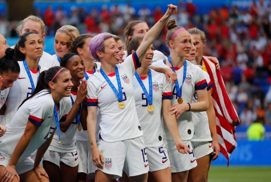 Jul 7, 2019; Lyon, FRANCE; United States forward Megan Rapinoe (15) and teammates celebrate after defeating the Netherlands in the championship match of the FIFA Women's World Cup France 2019 at Stade de Lyon.