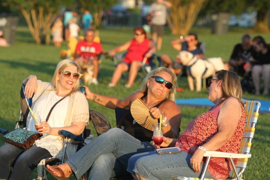 Visitors enjoy games, drinks, food trucks and live music at Friday Night Live at Old Glory Distilling Co. on July 12, 2019.