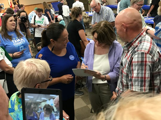 Sen. Amy Klobuchar signs an autograph during the 1st District Democrats Passport to Victory event on July 13, 2019 in Waterloo.