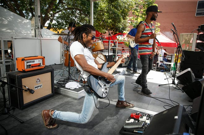 Guitarist King Wylde, left, and MarKaus perform at the Iowa Public Radio stage during the 80/35 music festival on Saturday, July 13, 2019, in Des Moines.