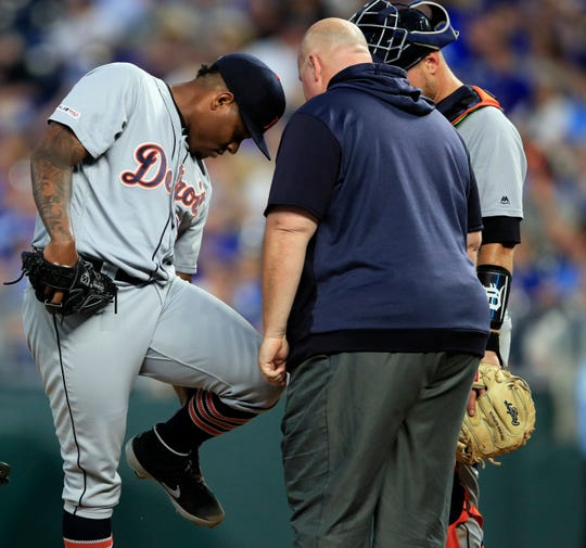 Detroit Tigers pitcher Gregory Soto is checked on by a trainer after getting hit by a batted ball during the fourth inning against the Kansas City Royals at Kauffman Stadium in Kansas City, Mo., Friday, July 12, 2019.