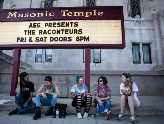 "Fans wait to see the Raconteurs outside the Masonic Temple in Detroit on Friday, July 12, 2019. They released their latest album, ""Help Us Stranger,"" last month."