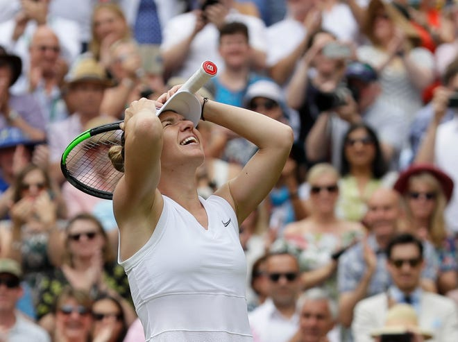 Simona Halep celebrates after defeating Serena Williams.
