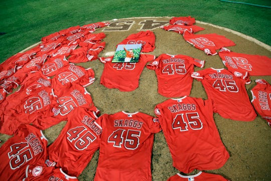 Jerseys with pitcher Tyler Skaggs' number are placed on the mound after the L.A. Angels completed a combined no-hitter against the Mariners on Friday.