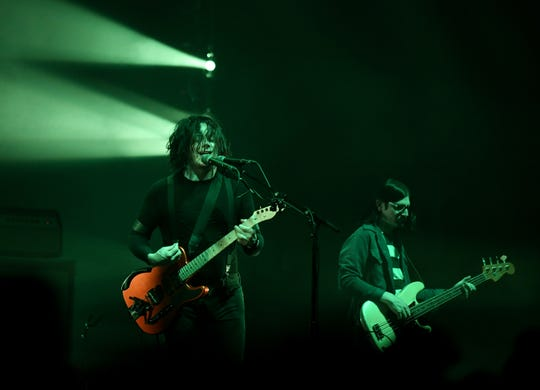 The Raconteurs play with Jack White on guitar and vocals, left, and Jack Lawrence on bass at the Masonic Temple in Detroit on July 12, 2019.