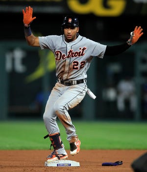 Detroit Tigers' Victor Reyes calls a timeout after his game-tying RBI double during the sixth inning on Friday.