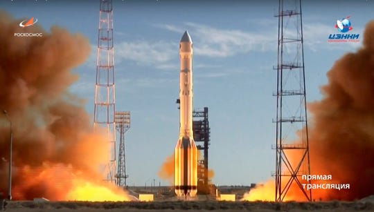 In this frame grab taken from video on Saturday, July 13, 2019, and distributed by Roscosmos Space Agency Press Service, a Russian Proton-M rocket takes off from the launch pad at Russia's space facility in Baikonur, Kazakhstan.
