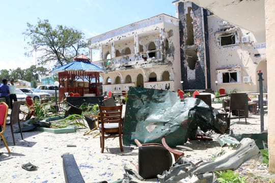 At least four al-Shabab assailants attacked the Asasey Hotel Friday evening, beginning with a suicide car bomb at the entrance gate and followed by an assault by gunmen who stormed the hotel, which is frequented by politicians, patrons and lawmakers.