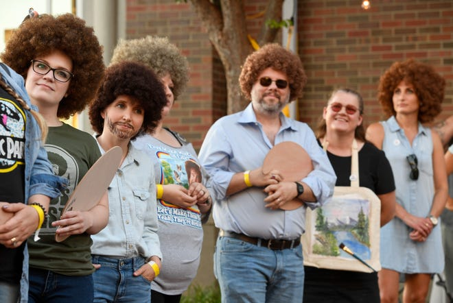 Contestants in the Bob Ross costume contest wait for their turn on stage at the WNIN Ross Fest celebrating the late artist/art instructor Bob Ross Friday, July 12, 2019.
