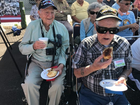 World War II veterans Dave Cunningham, left and Eugene Turnball enjoy coffee and doughnuts at the Wings of Freedom tour Saturday at the Northern Colorado Regional Airport in Loveland.