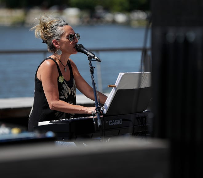 Shamrock City performs during the inaugural Rock the Dock music festival July 13, 2019, on CityDeck in downtown Green Bay.