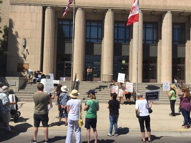A vigil was held at the Civic Center Saturday in protest of the Trump administration's immigration and detainment policies.