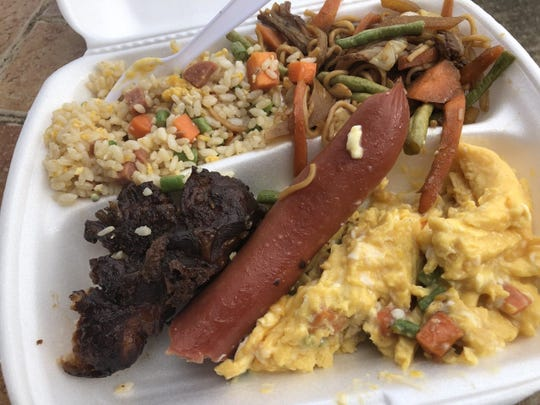 This 16-tala plate (about $6.50) I had at the Pacific Games in Samoa consists of fried rice, a noodle chop suey, a large hot dog and an adobo-style turkey tail that was marvelous.