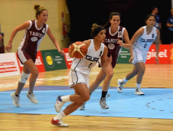 Derin Stinnett brings the ball downcourt during a game against Tahiti July 13 at the Pacific Games in Samoa.