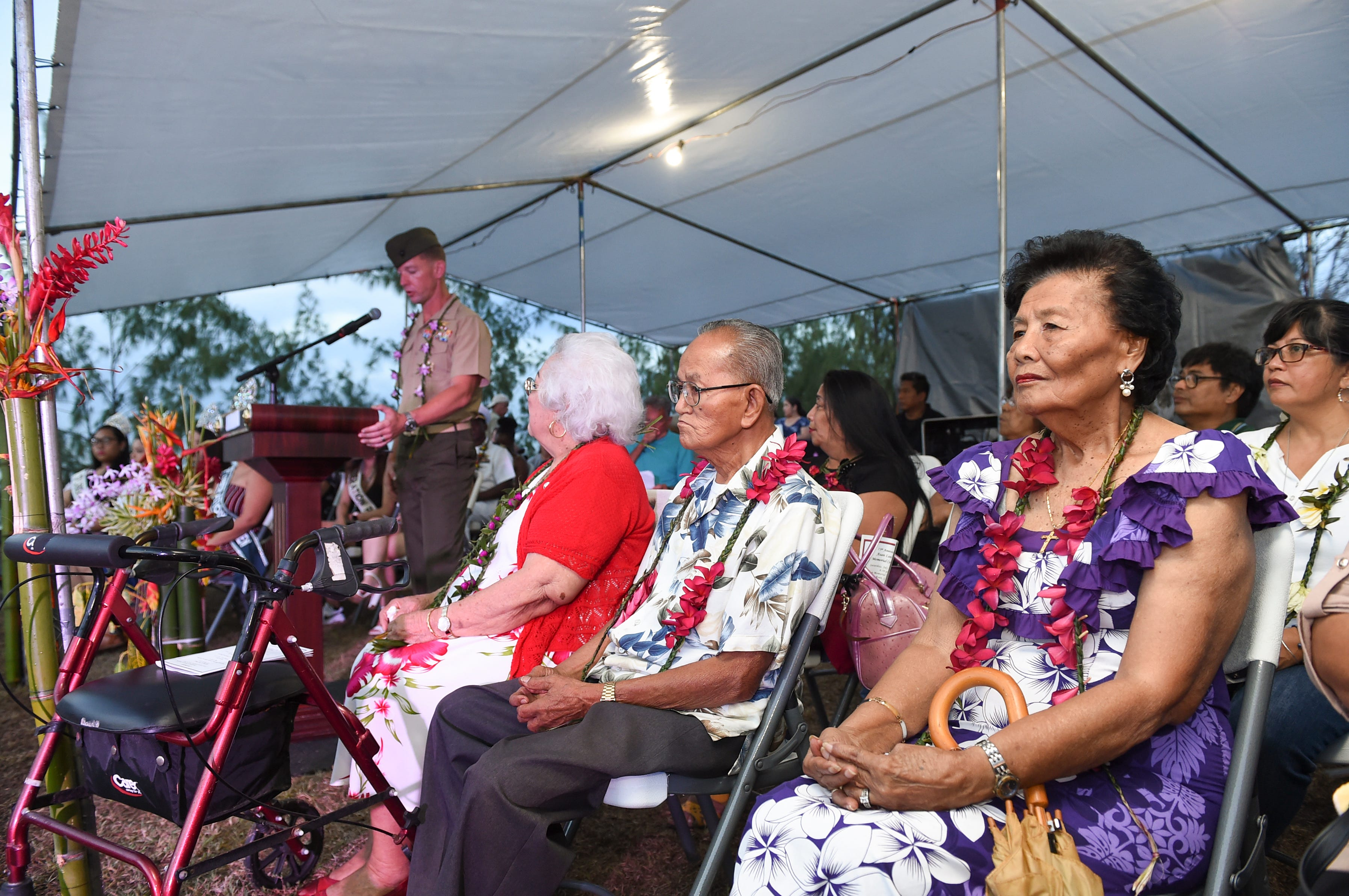 Attendees of the 75th Anniversary Asan Landing Memorial Ceremony pay tribute to the sacrifices made during Guam's liberation, at Asan Memorial Beach Park on July 13, 2019.