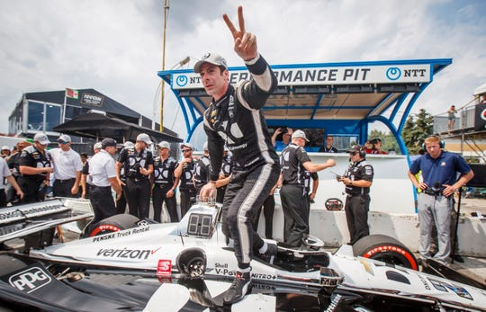 Simon Pagenaud celebrates after winning pole position during qualifying at the 2019 Honda Indy Toronto on Saturday.