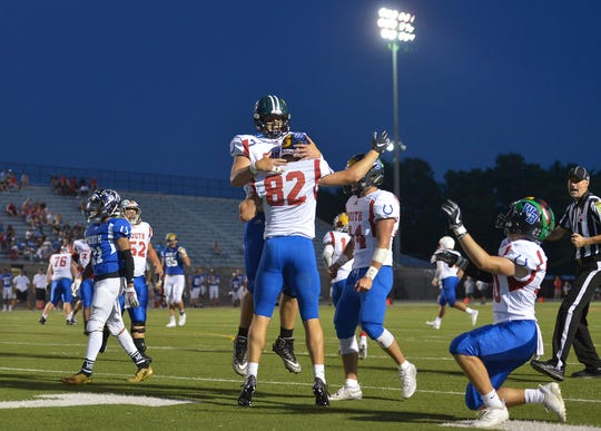 South All-Star Dawson Basinger, of North Central High School in Farmersburg, Ind., and Jon Eineman, of Mooresville High School, celebrate a touchdown against the North All-Stars in the second quarter of the IFCA All-Star Classic at North Central High School on Friday, July 12, 2019. The North won the 53rd All-Star Classic, its fifth straight win in the series.