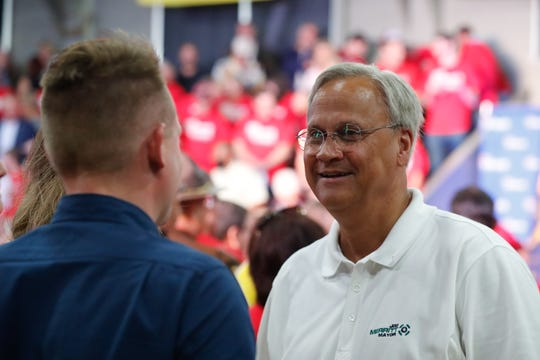 Senator and mayoral candidate, Jim Merritt, right, attends the reelection campaign kick off rally for Governor Eric Holcomb, held at the Hoosier Gym in Knightstown Ind. on Saturday, July 13, 2019.