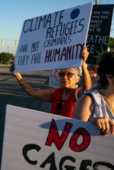 Annette King holds a sign on the side of Zionsville Road, as drivers honk and yell from their cars during Lights for Liberty Vigil to end human detention camps, Friday, July 12, 2019, at 5652 W. 73rd St., Indianapolis.
