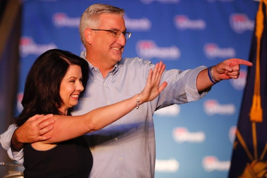 """Here in Indiana, we've become a leader, not just across the country, but around the world,"" Gov. Eric Holcomb said Saturday, July 13, 2019, at the announcement that he will run for reelection. He is shown here with his wife, Janet."