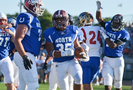 North All-Stars Christopher Harness, of Mishawaka High School, celebrates a touchdown against the South All-Stars in the first quarter of the IFCA All-Star Classic at North Central High School on Friday, July 12, 2019. The North won the 53rd All-Star Classic, its fifth straight win in the series.