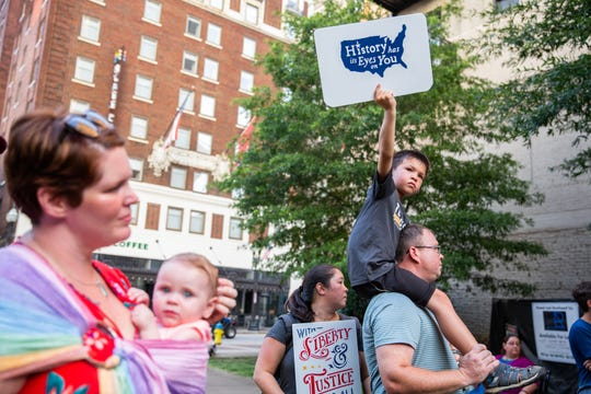 "JC, 7,  right, protests with his family during the Lights for Liberty rally at Krutch Park in downtown Knoxville Friday, July 12, 2019. The rally took place to support immigrants, families being separated at the border and to inform the community about the 287(g) program, an agreement to voluntarily detain immigrants for Immigration and Customs Enforcement, implemented by former Sheriff Jimmy ""J.J."" Jones."