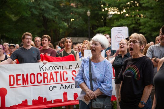 "Rally attendees participate in a chant during the Lights for Liberty rally at Krutch Park in downtown Knoxville Friday, July 12, 2019. The rally took place to support immigrants, families being separated at the border and to inform the community about the 287(g) program, an agreement to voluntarily detain immigrants for Immigration and Customs Enforcement, implemented by former Sheriff Jimmy ""J.J."" Jones."
