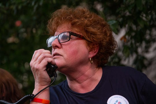 "Leader of Indivisible East Tennesse speaks during the Lights for Liberty rally at Krutch Park in downtown Knoxville Friday, July 12, 2019. The rally took place to support immigrants, families being separated at the border and to inform the community about the 287(g) program, an agreement to voluntarily detain immigrants for Immigration and Customs Enforcement, implemented by former Sheriff Jimmy ""J.J."" Jones."