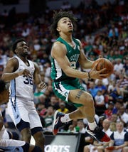 Boston Celtics' Carsen Edwards shoots around Memphis Grizzlies' Keenan Evans during the first half of an NBA summer league basketball game on Thursday, July 11, 2019, in Las Vegas.
