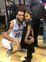 Purdue fifth-year senior Jahaad Proctor, shown here with his daughter, Jolene, after one of his games at High Point last season.