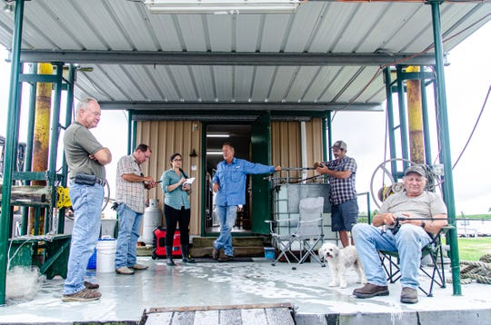 Residents in Intracoastal City, Louisiana, await the arrival of Hurricane Barry in July 2019. From left, Brad Pearson, Ted Morgan, Daily Advertiser reporter Leigh Guidry, Tony Morgan,  Jude Broussard and Craig Morgan.