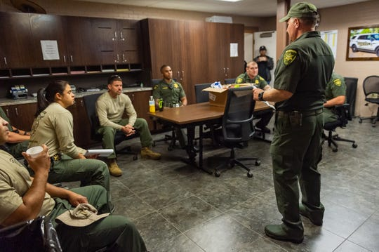 Lafayette Parish Sheriff's Department PIO John Mowell conducting briefing as deputies are working 12 hour shifts as Tropical Storm Barry approaches South Louisiana. Saturday, July 13, 2019.