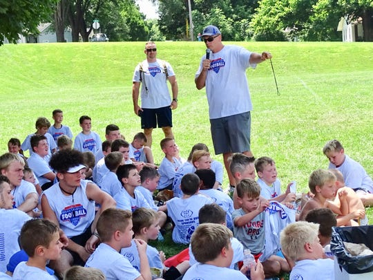 Former Lancaster and Ohio State standout Jim Cordle gives campers instructions during the Brian Sampson Memorial Youth Football Camp.
