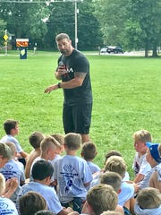 Former Ohio State linebacker Anthony Schlegel was one of the guest speakers during Friday's Brian Sampson Memorial Youth Football Camp.
