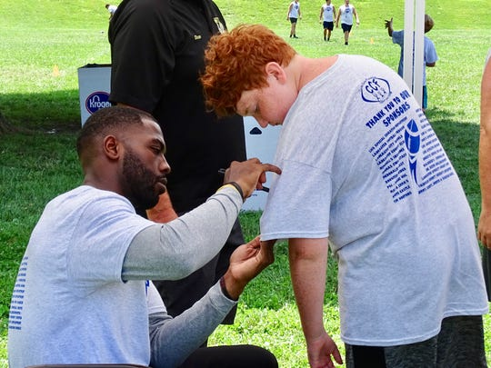 Former Ohio State quarterback J.T. Barrett was one of the guest speakers during Friday's Brian Sampson Memorial Youth Football Camp.