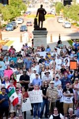 "Participants gather at the steps of the Michigan Capitol during the ""Lights for Liberty"" rally on Friday, July 12, 2019, in Lansing. The event was held to call attention to the treatment of immigrants in detention centers."